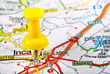 yellow thumbtack in a map. travel destinations