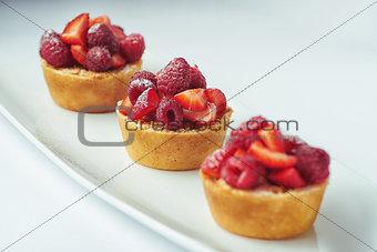 beautiful cake dessert with cream and berry