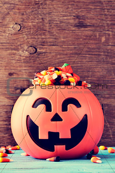 carved pumpkin full of halloween candies
