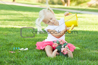 Little Girl Playing Gardener with Her Tools and Flower Pot