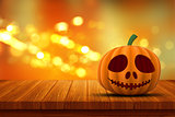3D Halloween pumpkin on a wooden table with bokeh lights backgro