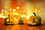 3D Halloween pumpkins on a bokeh lights background