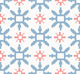 Christmas knitted seamless pattern with blue and red snowflakes
