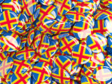 Background with round pins with flag of aland islands