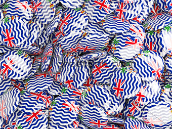 Background with round pins with flag of british indian ocean ter