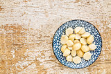 macadamia nuts on ceramic bowl