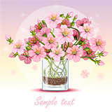 background with cherry blossom in a glass