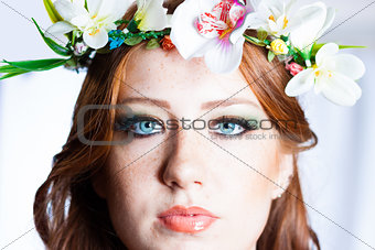 Beautiful long red hair girl with a flowers crown