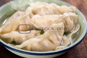 Close up fresh dumplings soup