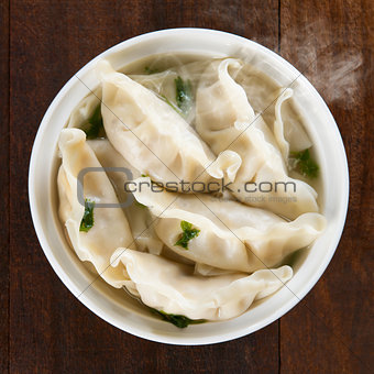 Top view Asian dish dumplings soup