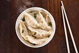 Top view Asian meal dumplings soup