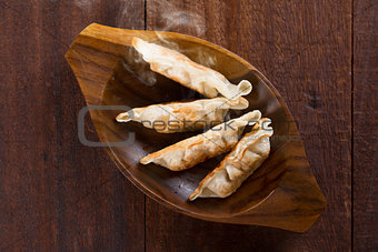 Top view Asian meal pan fried dumplings