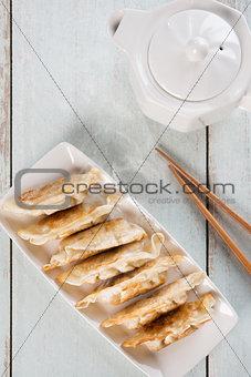 Top view Asian food pan fried dumplings