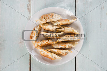 Top view Asian appetizer pan fried dumplings