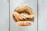 Top view Asian gourmet pan fried dumplings