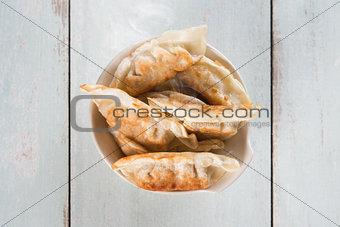 Top view Asian gourmet pan fried dumplings