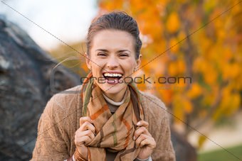 Portrait of woman relaxing in beautiful evening autumn park