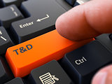 Pressing Orange Button T and D on Black Keyboard.