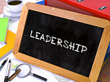 Handwritten Leadership on a Chalkboard.
