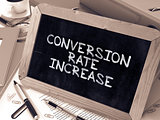 Conversion Rate Increase - Chalkboard with Hand Drawn Text.