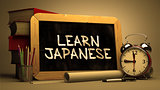 Learn JapaneseHandwritten by white Chalk on a Blackboard.