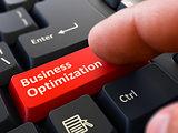 Business Optimization - Written on Red Keyboard Key.