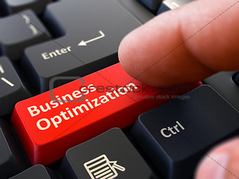 Business Optimization - Written on Red Keyboard Key.
