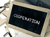 Cooperation - Chalkboard with Hand Drawn Text.