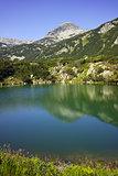 Reflection of Muratov peak in Okoto lake