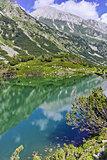 Reflection of Vihren peak in Okoto lake, Pirin Mountain