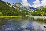 Reflection of Muratov peak in Mountain river, Pirin Mountain