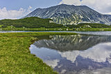 Reflection of Todorka peak in Muratovo lake, Pirin Mountain