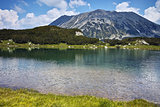Reflection of Todorka peak in Muratovo lake, Pirin Mountain
