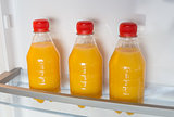 Open fridge filled with orange juice