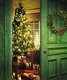 Door opening into a room with Christmas tree