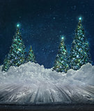 Holiday background with Christmas trees in snow