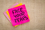 Face your fears advice on sticky note