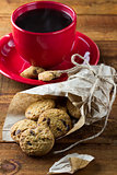 cup of coffee and oatmeal cookies with chocolate. vertical