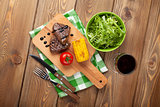 Steak with grilled corn, salad and red wine