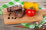 Steak with grilled corn and tomato