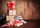 Christmas gift boxes and tree branch
