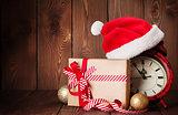 Christmas gift box, alarm clock and santa hat