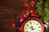 Christmas alarm clock, tree branch and lights