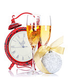 Two champagne glasses, christmas decor and clock