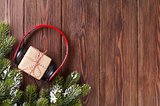 Christmas gift box with headphones and tree branch