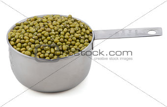 Green mung beans in a measuring cup