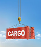 Metal freight shipping containers on the hooks at sky background
