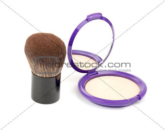 Face powder with kabuki brush