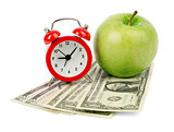 Fresh apple with dollars and alarm clock