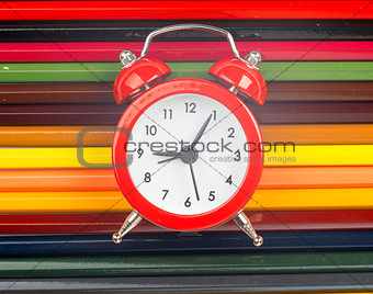 Alarm clock on crayons